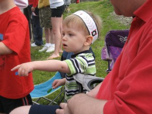 Quin pointing at one of the many fire trucks in the Memorial Day parade.